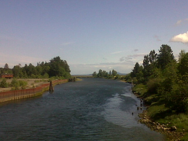 River under almost blue sky. Courtenay, British Columbia Canada