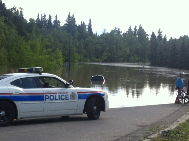 sunken car in a flooded park! Calgary, Alberta Canada