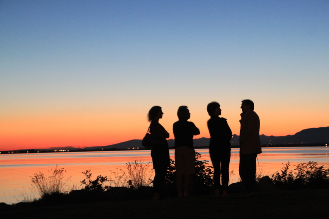gathering at sunset White Rock, British Columbia Canada