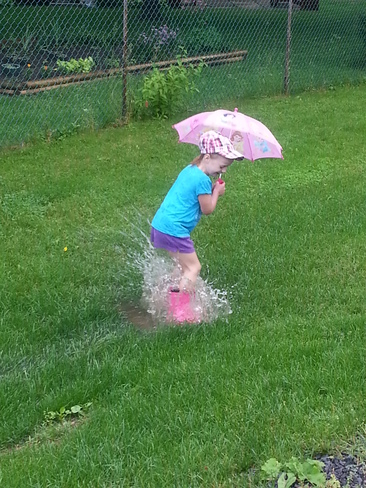 Splashing in the rain! Kingston, Ontario Canada