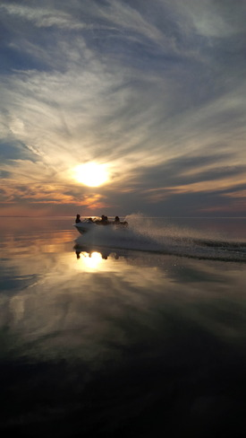 Boating in the sunset Dillon, Saskatchewan Canada