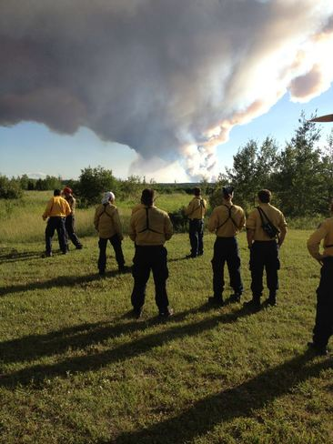 Fire Fighter Looking towards Forest Fire. Thompson, Manitoba Canada