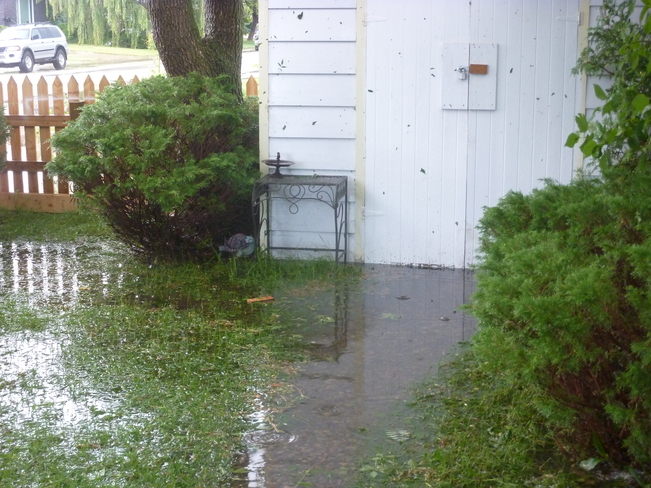 my back yard flood Lethbridge, Alberta Canada