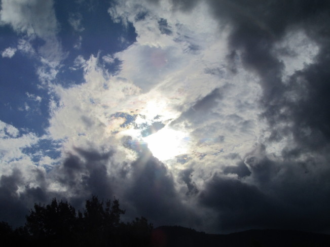 Sun trying to peak though stormy clouds Vernon, British Columbia Canada