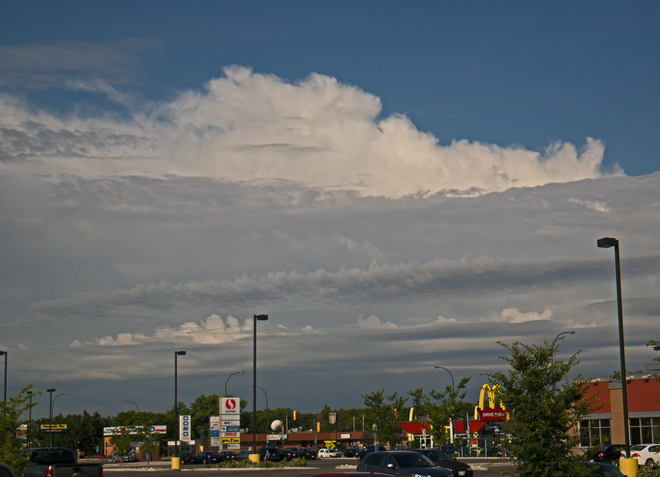 Cumulus cloud looms above River East Shopping center,