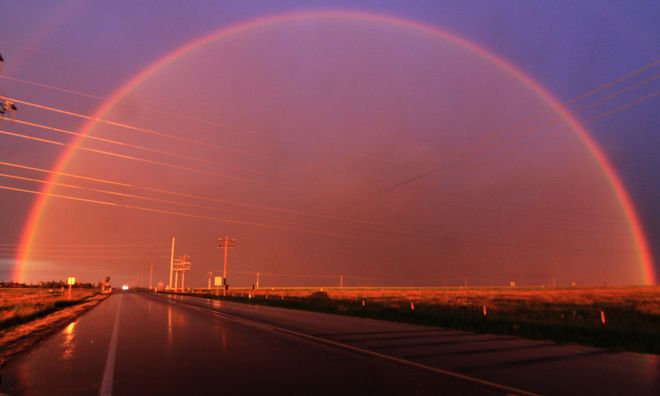 sunset rainbow Brooks, Alberta Canada