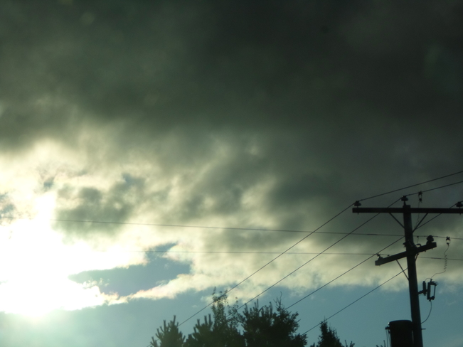 Very dark clouds over E.L. Elliot Lake, Ontario Canada