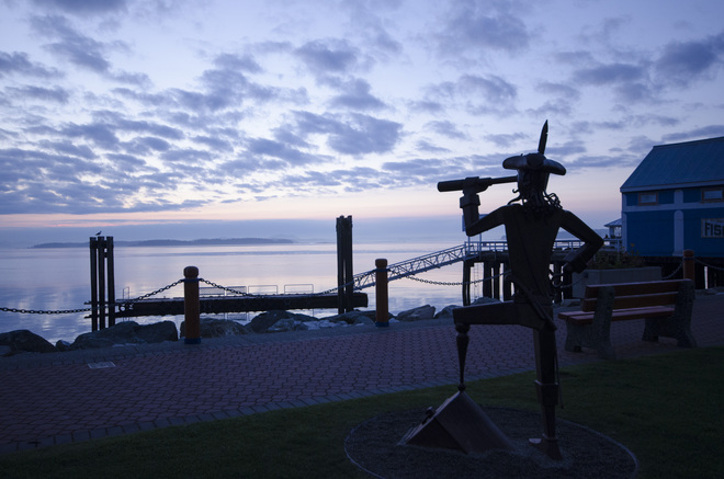 "'Captain Hook"" watches the dawn approach Sidney, British Columbia Canada"