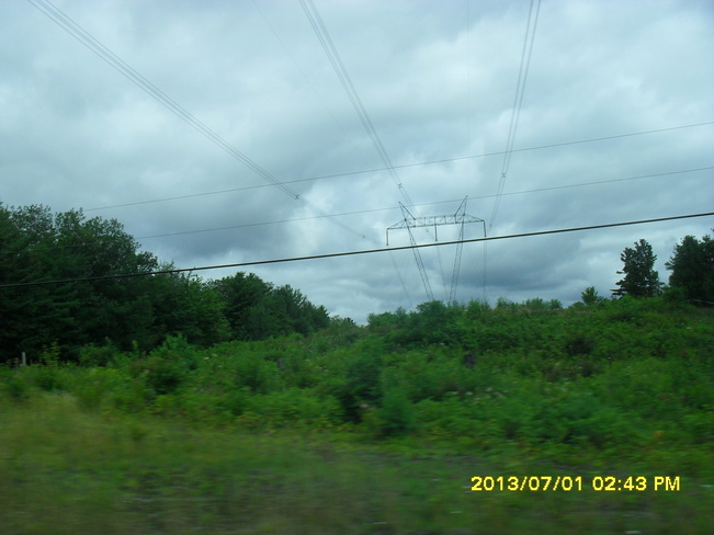 Clear Cut trees around Transmission Lines on an Ovecast day...remembering August Parry Sound, Ontario Canada