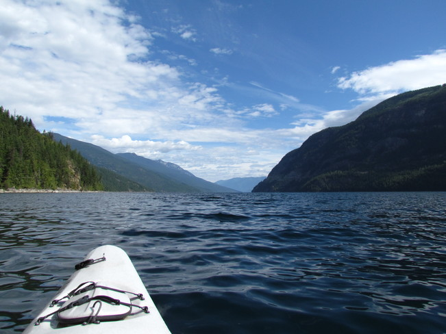KAYAKING ON SLOCAN LAKE Slocan, British Columbia Canada