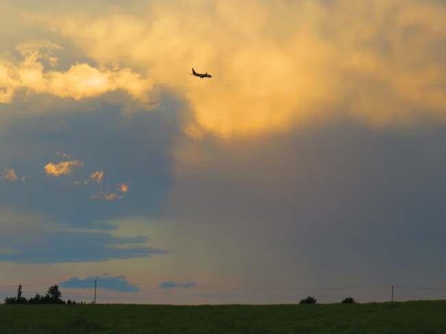 Plane Flyin' Around the Storm Devon, Alberta Canada