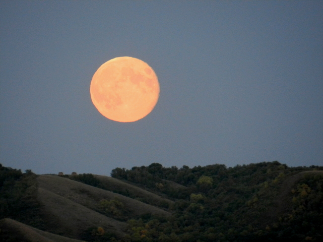 Huge moon over the hills Fort Qu'Appelle, Saskatchewan Canada