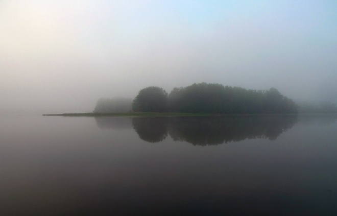 Misty morning on the Mille Isles river. Rosemère, Quebec Canada