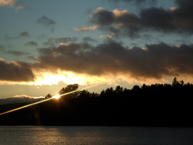 Sunset with beam of light Elliot Lake, Ontario Canada