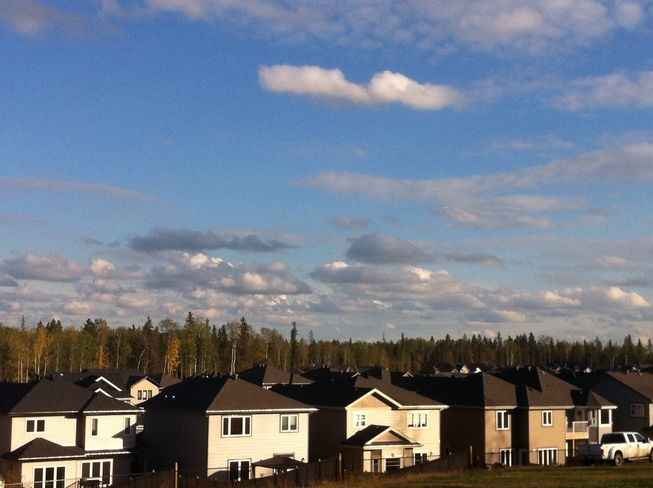 floating clouds Fort McMurray, Alberta Canada