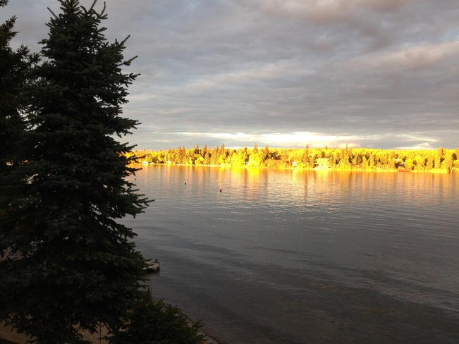 View across the lake at sunset Stenen, Saskatchewan Canada