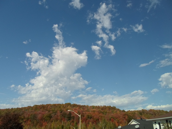 Blue skies,white clouds & colorful hill Elliot Lake, Ontario Canada