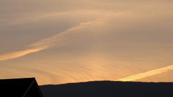 jet trails in the sunset Salmon Arm, British Columbia Canada