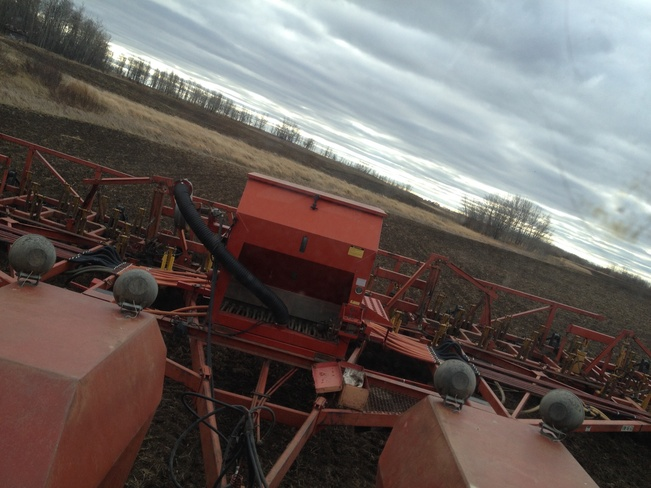 Windy & cloudy cultivating Norquay, Saskatchewan Canada