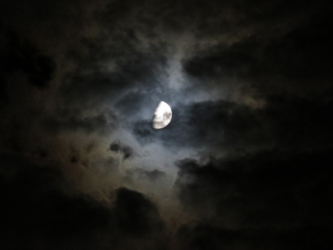 Clouds wont stop the moon from showing off her painted face. Hanmer, Ontario Canada