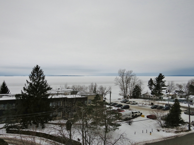 Ice covering most of Lake Nipissing. North Bay, Ontario Canada