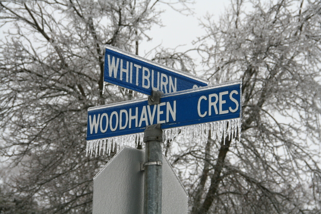 Street signs with ice Whitby, Ontario Canada