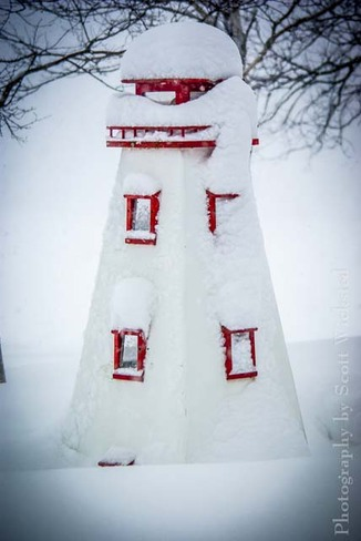 Light house covered in snow Huntley, Prince Edward Island Canada