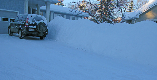 massive pile of snow to date Lacombe, Alberta Canada