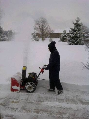Cleaning-up overnight snowfall in preparation for Sunday snowfall Bayfield, Ontario Canada