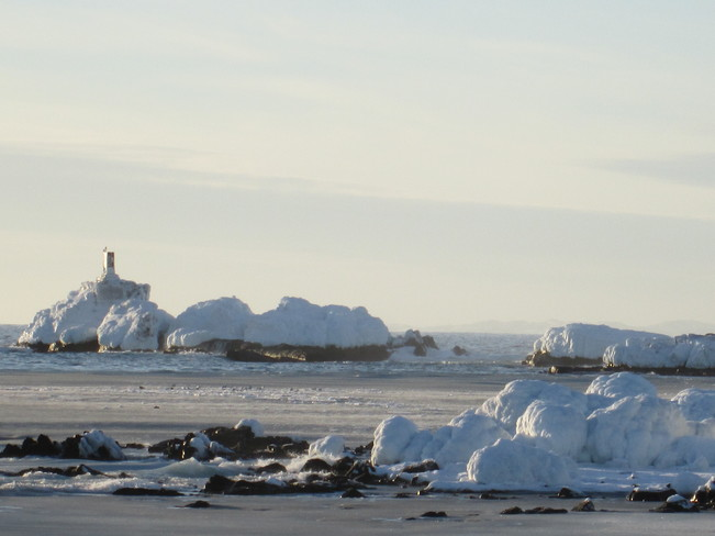 mini lighthouse iced over Bonavista, Newfoundland and Labrador Canada