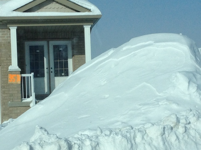 snow almost close to roof Angus, Ontario Canada