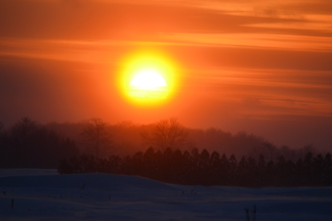 sun setting on a blizzard Perth South, Ontario Canada