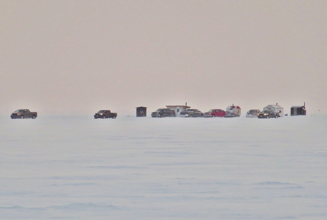 'Convoy' of trucks rolling over the ice. North Bay, Ontario Canada