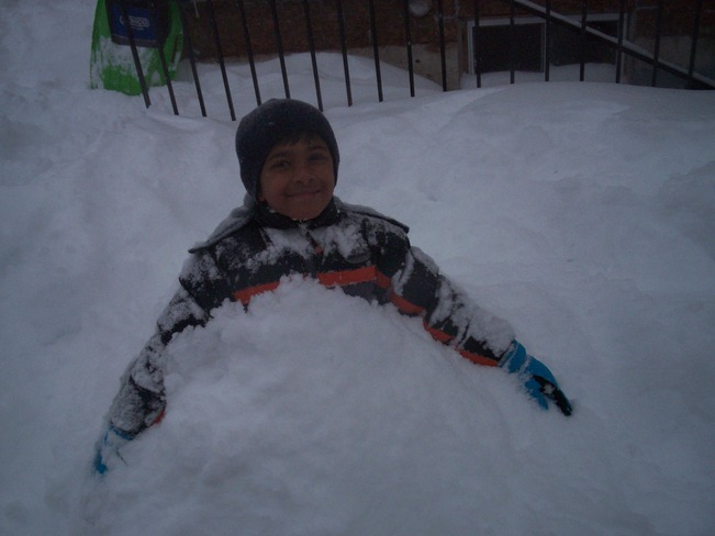 Kid playing in the snow Thornhill, Ontario Canada