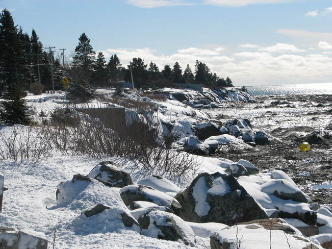 snow covered rocks Maces Bay, New Brunswick Canada