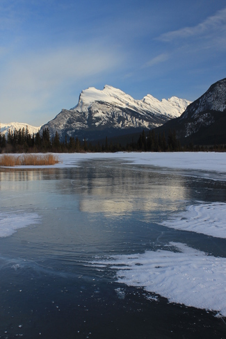 Clear lake ice and Mt. Rundle Banff, Alberta Canada