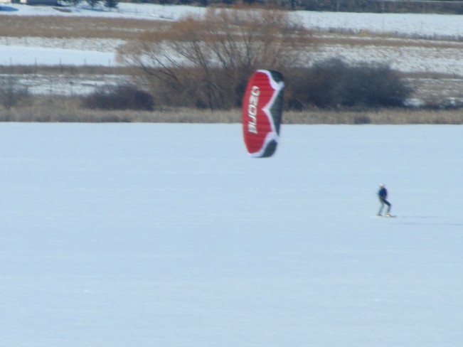 Wind snowboarding on swan lake Vernon, British Columbia Canada