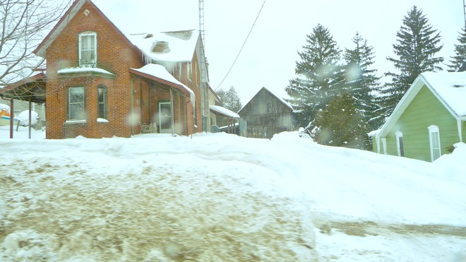 Huge snowbanks along the main road. Warkworth, Ontario Canada