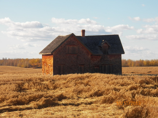 House blending with fall colours Bonnyville, Alberta Canada
