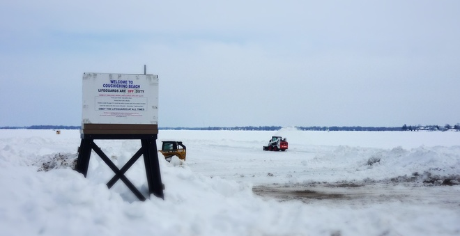 Clearing the snow of the beach. Orillia, Ontario Canada