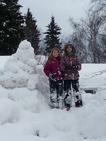 Building a snow family on Valentines Day! Prince George, British Columbia Canada