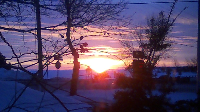 Sunrise over the frozen river Bouctouche, New Brunswick Canada