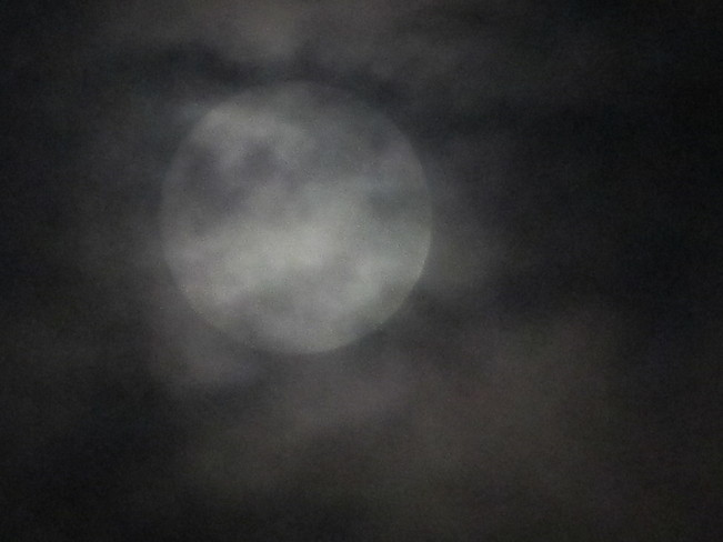 creepy full moon Vernon, British Columbia Canada