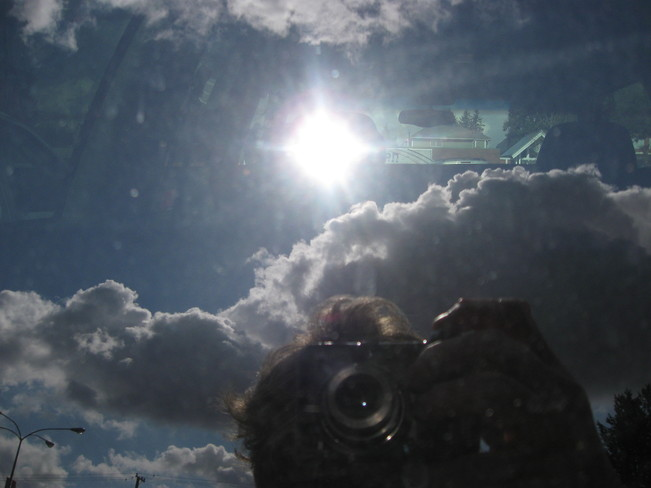 me & the sun's reflection through my truck window Surrey, British Columbia Canada