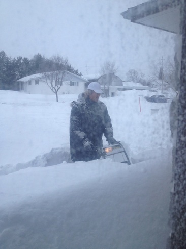Snowblowing before breakfast Dryden, Ontario Canada