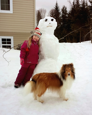 Keira with her last snowman of the year Quispamsis, New Brunswick Canada