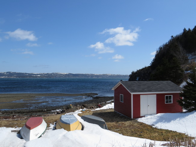 snow is going boats soon be out Mooring Cove, Newfoundland and Labrador Canada