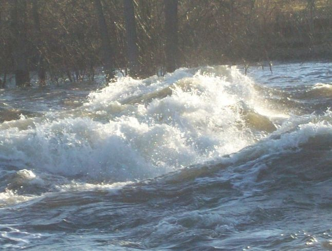 Large Waves and an Eddy signal the dangers occuring on the Moira River Belleville, Ontario Canada