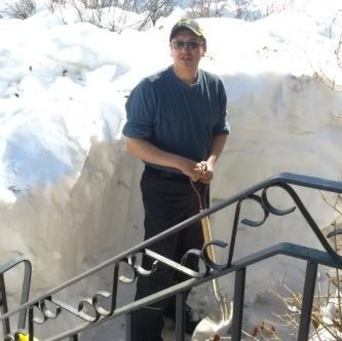 my dad shoveling alot of snow! Thompson, Manitoba Canada