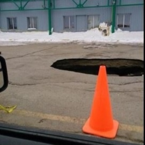 big hole by The Plaza Thompson, Manitoba Canada